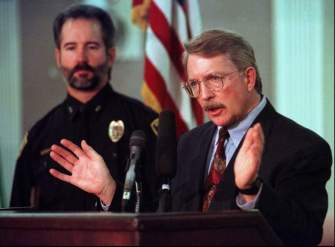 District Attorney Alex Hunter, right, answers questions, Feb. 13, 1997, about the murder of 6-year-old JonBenet Ramsey during a news conference with Boulder Police chief Tom Koby in Boulder, Colo. Nearly a year after the Dec. 26, 1996, crime, no suspects have been named.(AP Photo/Joe Mahoney, FILE)