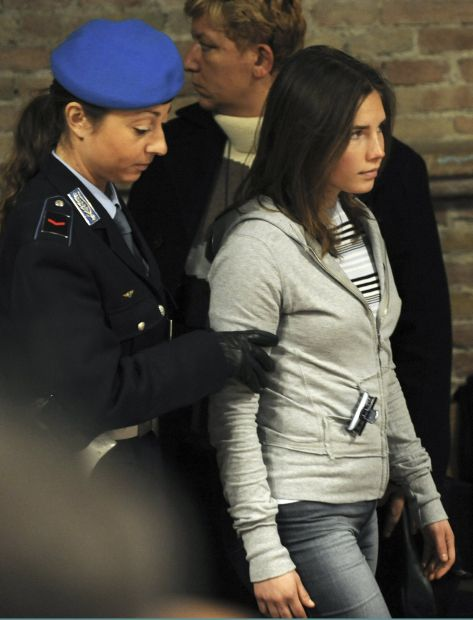 American suspect Knox arrives at her trial for the murder of British student Kercher in Perugia