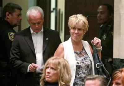 George and Cindy Anthony enter the courtroom for daughter Casey's sentencing at the Orange County Courthouse in Orlando