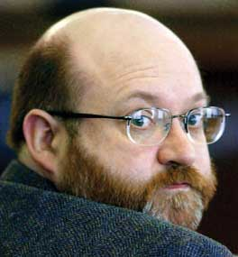 Indle King G. Jr. looks over his shoulder to the gallery during his murder trial in Everett, Wash., in this Feb. 21, 2002, file photo. King was convicted in the September 2000 death of his second mail-order bride, Anastasia Solovieva King. Congress is seeking to impose federal oversight over this loosely regulated, Internet-based industry, enabling foreign women seeking American husbands to learn the criminal background of men courting them.