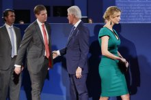 Former president Bill Clinton, third from left, shakes hands with, from left, Donald Trump Jr., Eric Trump, and Ivanka Trump before the beginning of the second presidential debate at Washington University, Sunday, Oct. 9, 2016, in St. Louis. (AP Photo/ Evan Vucci)