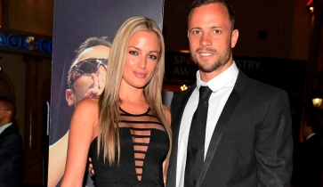 "Oscar Pistorius (R) and his girlfriend Reeva Steenkamp pose for a picture in Johannesburg, February 7, 2013. South African ""Blade Runner"" Oscar Pistorius, a double amputee who became one of the biggest names in world athletics, was charged on February 14, with shooting dead his girlfriend at his home in Pretoria. Picture taken February 7, 2013. REUTERS/Thembani Makhubele (SOUTH AFRICA - Tags: CRIME LAW SPORT ATHLETICS) - RTR3DS4U"