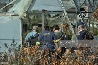 PORT ELIZABETH, SOUTH AFRICA AUGUST 14: (SOUTH AFRICA OUT): Police and forensic investigators at the crime scene where Mark Minnie was found dead on August 14, 2018 in Port Elizabeth, South Africa. Minnie, who co-authored, The Lost Boys of Bird Island book that implicates two powerful apartheid officials and a businessperson in an alleged paedophile ring, was found with a bullet wound to his head and a firearm was found near his body, on a farm in Port Elizabeth. (Photo by Lulama Zenzile/Netwerk24/Gallo Images/Getty Images)