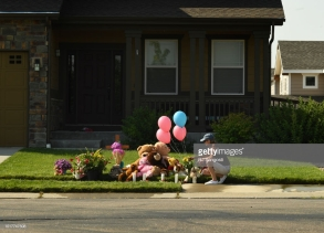 FREDERICK, CO - AUGUST 16: Terry Warren, of Frederick, taks a moment at a makeshift memorial to Shanann, Bella and Celeste Watts, who have been missing since Monday, is seen outside the family home on August 16, 2018 in Frederick, Colorado. Frederick police have arrested Shananns husband Christopher Watts on suspicion of murdering the three. (Photo by RJ Sangosti/The Denver Post via Getty Images)