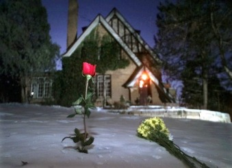 RAMSEYHOUSE.JPG Flowers rest in the snow outside the home of JonBenet Ramsey on the one-year anniversary of her murder, Friday Dec. 26, 1997, in Boulder, Colo. A candlelight vigil was scheduled for later in the evening. (AP Photo/Michael S. Green)
