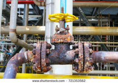 stock-photo-heavily-corroded-valve-s-body-bolts-and-nuts-in-oil-and-gas-refinery-petrochemical-plant-721353562
